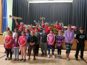 Celebrating with members of the Woodland School Band after the fund raising concert